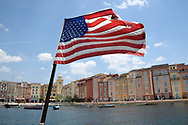 An American flag flies from the back of a boat with a view of the Loews Portofino Bay Hotel at Universal Orlando in Orlando, Fla., Wednesday, May 3, 2017. (Phelan M. Ebenhack via AP)