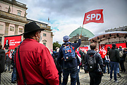 A supporter waves a flag with the SPD logo during an election campaign event of the German Social Democratic Party (SPD) at Bebelplatz square In Berlin, Germany, August 27, 2021. Germany's federal elections are due to take place on September 26, 2021.