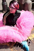 May 1st 2011. MayDay demonstration Clerkenwell Green. Young woman wearing a pink tutu