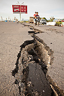 Padang, Western Sumatra, Indonesia, 7th October 2009:?Large cracks created by the force of the earthquake on JL  Puruih in Padang following a devastating earthquake in Western Sumatra that claimed the lives of an estimated 2000 people.?Photo: Joseph Feil