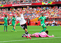 June 07, 2015: Forward Anja Mittag (#11) of Germany celebrates after scoring during the FIFA 2015 Women's World Cup Group B match between Germany and Côte d'Ivoire which Germany won 10-0 at Lansdowne Park in Ottawa, Canada.