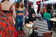 The Tranny Tarot reader. The Art Car Boot Fair in a car park just off Brick Lane in East London. This is an alternative art event where artists show their works and engage with the public. The Art Car Boot Fair was an idea that grew out of a desire to re-introduce some summer fun and frivolity into a thriving but increasingly commercial London art scene. The aim for the Art Car Boot Fair is to be a day when the artists let their hair down and for all-comers to engage with art in a totally informal way, and to pick up some real art bargains.