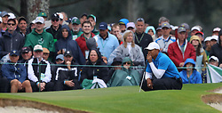 April 7, 2018 - Augusta, GA, USA - Tiger Woods lines up a putt on the 7th green during the third round of the Masters Tournament on Saturday, April 7, 2018, at Augusta National Golf Club in Augusta, Ga. (Credit Image: © Curtis Compton/TNS via ZUMA Wire)