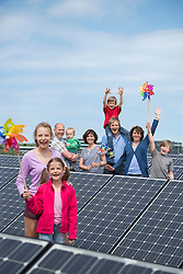 Large family solar panel electricity happy