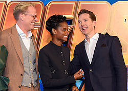 Paul Bettany (left), Letitia Wright (centre) and Benedict Cumberbatch attending the Avengers: Infinity War UK Fan Event held at Television Studios in White City, London.