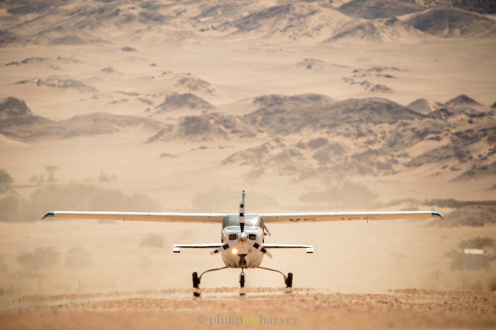 Aircraft on landing strip, The Kaokoveld Desert, Kaokoland, Northern Namibia, Southern Africa