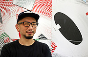 Artist Tohru Matsushita in front of a painting during his SNOW Contemporary Art exhibition 2018 January Tokyo Japan