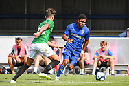 AFC Wimbledon Midfielder Andy Barcham (17) and Brighton & Hove Albion Defender Ben White (22) battle for the ball during the Pre-Season Friendly match between AFC Wimbledon and Brighton and Hove Albion at the Cherry Red Records Stadium, Kingston, England on 21 July 2018. Picture by Stephen Wright.