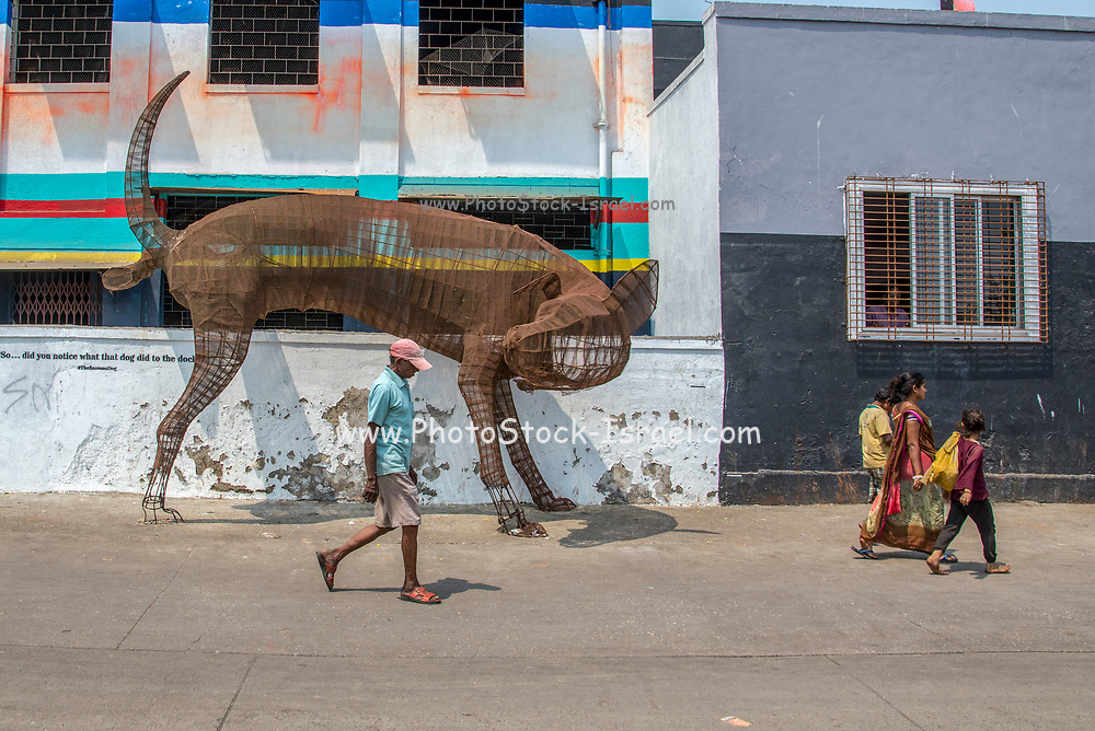 The Sassoon Dog. an iron sculpture of a urinating dog at the Sassoon Docks in Mumbai, India
