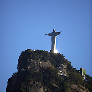The iconic Cristo Redentor, Christ the Redeemer statue sits atop the mountain Corcovado. The Christ statue was voted one of the seven wonders of the modern world in 2007. It was designed by Brazilian Heitor de Silva Costa and was inaugurated in 1931 having taken years to assemble. Rio de Janeiro, Brazil. 23rd July 2010. Photo Tim Clayton..