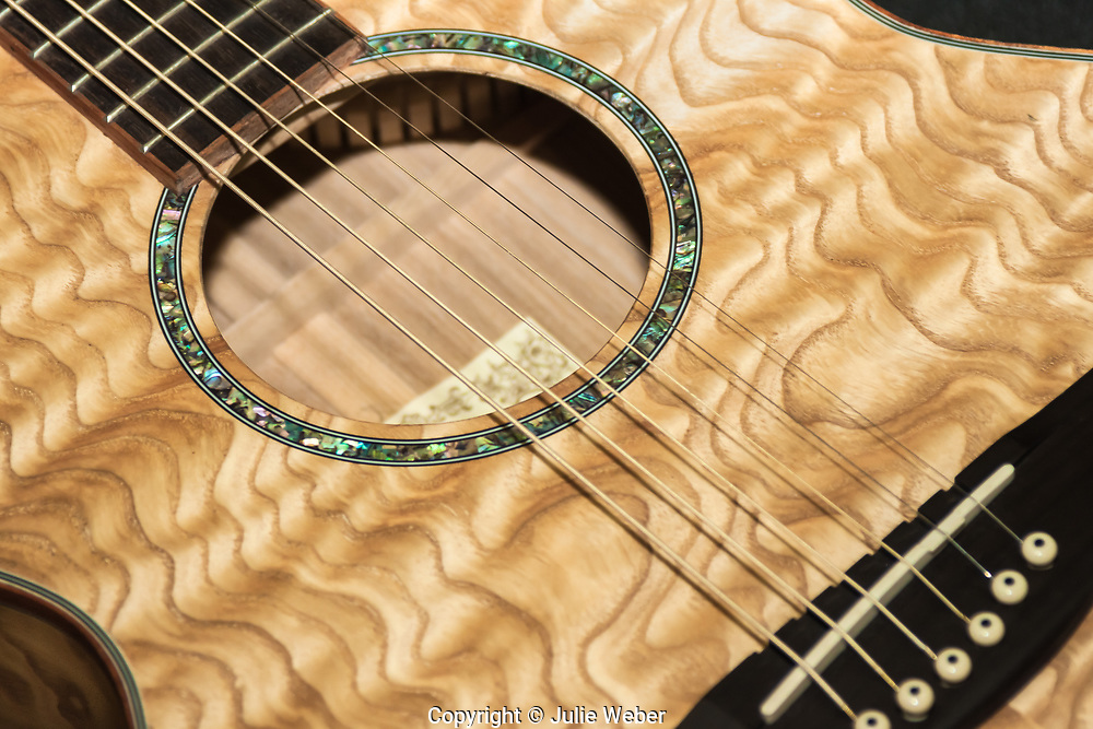 """Image of a beautifully designed guitar with beautiful golden toned wavy wood grain and mother of pearl inlay. <br /> <br /> For IMAGE LICENSING just click on the """"add to cart"""" button above.<br /> <br /> Fine Art archival paper prints for this image as well as canvas, metal and acrylic prints available here:<br /> https://2-julie-weber.pixels.com/featured/pretty-guitar-julie-weber.html"""