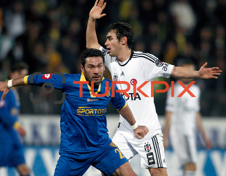 Besiktas's Veli Kavlak (R) during their Turkish Superleague soccer match Ankaragucu between Besiktas at the 19 Mayis stadium in Ankara Turkey on Sunday 08 January 2012. Photo by TURKPIX