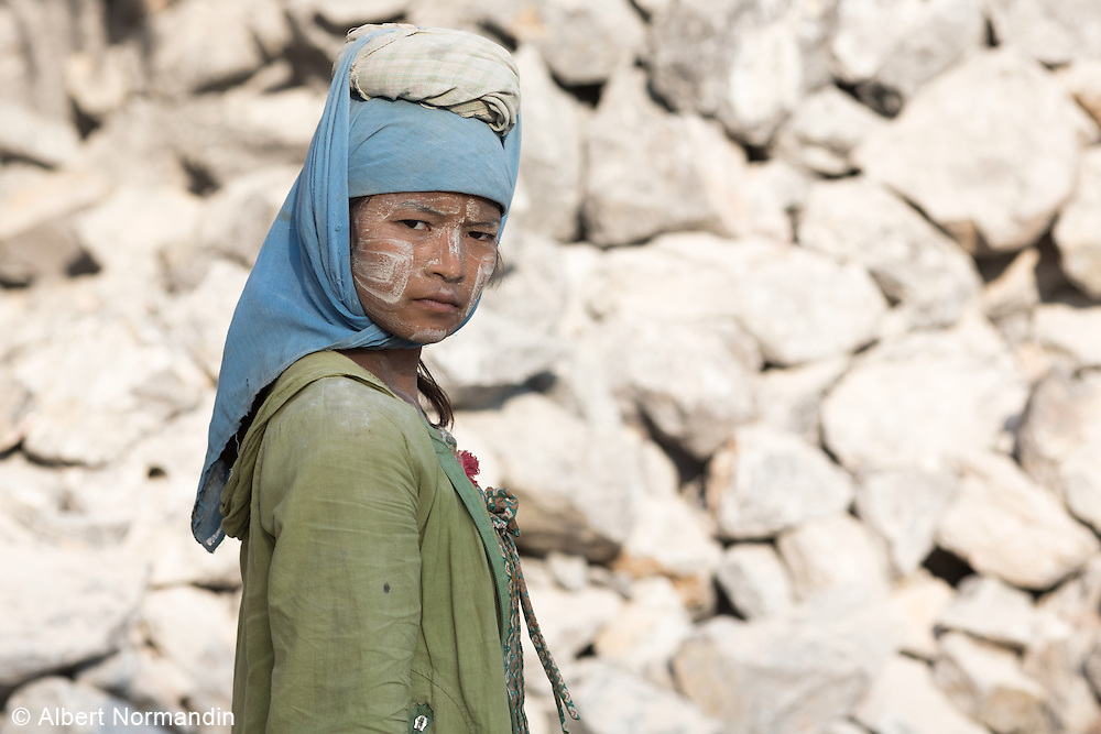 Woman rock quarry worker looks to the camera, Hpa-an