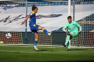 AFC Wimbledon midfielder Ethan Chislett (11) trying to block Plymouth Argyle goalkeeper Michael Cooper (1) from clearing the ball during the EFL Sky Bet League 1 match between AFC Wimbledon and Plymouth Argyle at the Kiyan Prince Foundation Stadium, London, England on 19 September 2020.