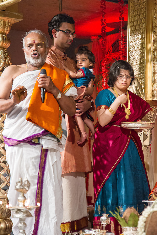 Pearland, Texas: With the priest, brother-in-law Ananth Shankar, and niece Rukmini, Hema Ramaswamy participates in the Hindu ceremonies on stage to mark her father's 60th birthday at the Meenakshi temple on May 9, 2014.