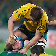 Ireland's Jamie Heaslip is roughed up by Ben McCalman, Australia, during the Australia V Ireland Pool C match during the IRB Rugby World Cup tournament. Eden Park, Auckland, New Zealand, 17th September 2011. Photo Tim Clayton...