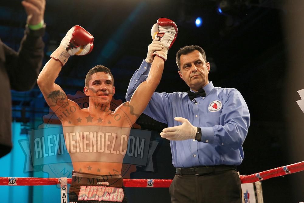 Henry Lebron defeats Ronnie Jordan during a Telemundo boxing match between at Osceola Heritage Park on Friday, February 23, 2018 in Kissimmee, Florida.  (Alex Menendez via AP)