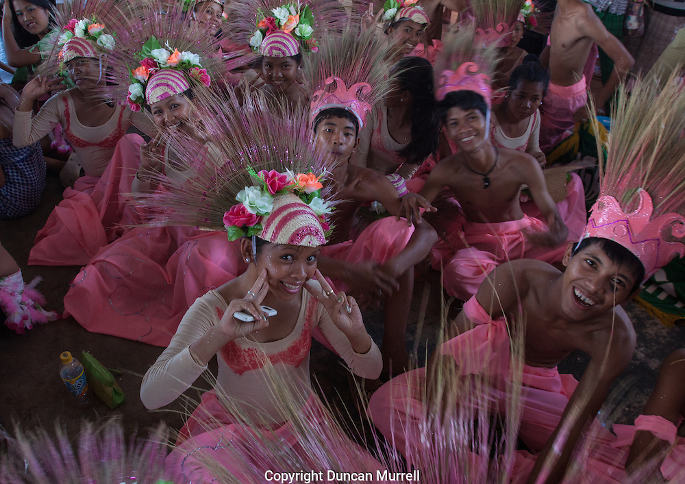 Dancers at the presentation of prizes for the Balayong Festival street dancing competition. The festival at the beginning of March commemorates the founding anniversary of the City of Puerto Princesa, Palawan, highlighted by balayong tree-planting, street dancing and a colourful floral parade depicting the Palawan cherry blossoms from which the festival derives its name. The Palawan cherry is one of the most popular flowering trees in Palawan and known by the locals as the Balayong, a beautiful tree that when it is in full bloom resembles the cherry blossoms of Japan.