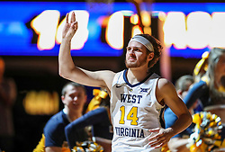 Dec 22, 2018; Morgantown, WV, USA; West Virginia Mountaineers guard Chase Harler (14) is announced during the starting lineups before their game against the Jacksonville State Gamecocks at WVU Coliseum. Mandatory Credit: Ben Queen-USA TODAY Sports