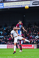 Rory McArdle of Scunthorpe United (23) heads above Michael Doyle of Coventry City (8) during the EFL Sky Bet League 1 match between Scunthorpe United and Coventry City at Glanford Park, Scunthorpe, England on 5 January 2019.