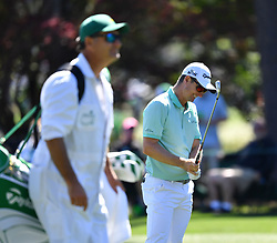 Justin Rose reacts to his second shot on the 8th fairway during the third round of the Masters Tournament at Augusta National Golf Club in Augusta, Ga., on Saturday, April 8, 2017. (Photo by Brant Sanderlin/Atlanta Journal-Constitution/TNS) *** Please Use Credit from Credit Field ***