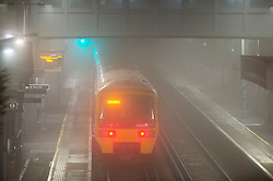 © Licensed to London News Pictures. 27/11/2020. <br /> New Eltham, UK. A train in the fog at New Eltham, London. Freezing foggy weather conditions this Friday morning across large parts of the UK.  Photo credit:Grant Falvey/LNP