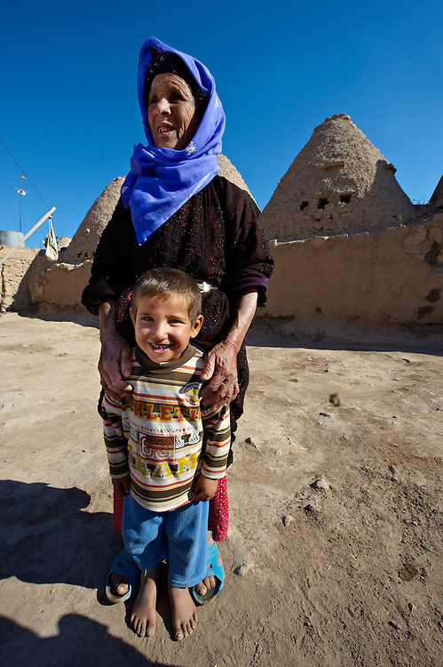 """Pictures of the beehive adobe buildings of Harran, south west Anatolia, Turkey.  Harran was a major ancient city in Upper Mesopotamia whose site is near the modern village of Altınbaşak, Turkey, 24 miles (44 kilometers) southeast of Şanlıurfa. The location is in a district of Şanlıurfa Province that is also named """"Harran"""". Harran is famous for its traditional 'beehive' adobe houses, constructed entirely without wood. The design of these makes them cool inside. 30 .<br /> <br /> If you prefer to buy from our ALAMY PHOTO LIBRARY  Collection visit : https://www.alamy.com/portfolio/paul-williams-funkystock/harran.html<br /> <br /> Visit our TURKEY PHOTO COLLECTIONS for more photos to download or buy as wall art prints https://funkystock.photoshelter.com/gallery-collection/3f-Pictures-of-Turkey-Turkey-Photos-Images-Fotos/C0000U.hJWkZxAbg ."""