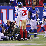 New York Giants quarterback Eli Manning, (right), after his team loss as team mate Odell Beckham Jr, reflects on his dropped catch towards the end of the game during the New York Giants V San Francisco 49ers, NFL American Football match at MetLife Stadium, East Rutherford, NJ, USA. 16th November 2014. Photo Tim Clayton