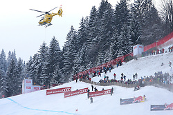 KITZBUHEL AUSTRIA. 22-01-2011.  The rescue helicopter flies over the traverse on its way to assist Siegmar Klotz (ITA) who crashed out of the 71st Hahnenkamm downhill race part of  Audi FIS World Cup races in Kitzbuhel Austria.  Mandatory credit: Mitchell Gunn