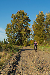 United States, Washington, Kirkland, woman walking on railroad track on site of future Kirkland Corridor rail trail.  MR
