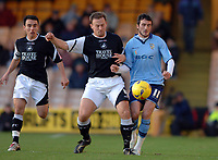 Photo: Paul Greenwood.<br />Port Vale v Swansea City. Coca Cola League 1. 18/11/2006. Swansea's Kristian O'Leary, left and Vale's Jeff Smith battle for the ball.