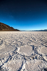 """""""Badwater Basin at Night 3"""" - Predawn photograph of the Badwater Basin salt flat in Death Valley, California. The Milky Way can be seen in the sky."""