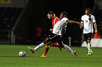 Pictured: Joseph (Joe) Ledley of Wales challenged by David Alaba of Austria. Wednesday 06 February 2013..Re: Vauxhall International Friendly, Wales v Austria at the Liberty Stadium, Swansea, south Wales.