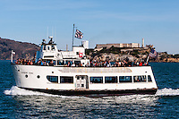 United States, California, San Francisco. Tourist boat with Alcatraz in the background.