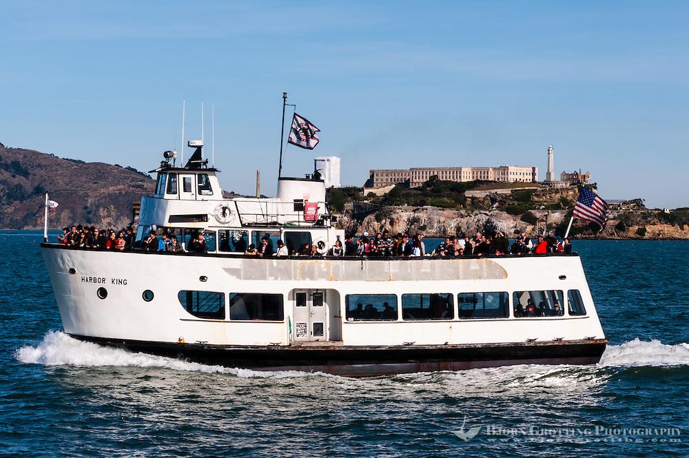 United States, California, San Francisco. Tourist boat with Alcatraz in the background.
