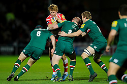 Gloucester Inside Centre (#12) Billy Twelvetrees is tackled by Leicester Number 8 (#8) Thomas Waldrom and Prop (#3) Dan Cole during the first half of the match - Photo mandatory by-line: Rogan Thomson/JMP - Tel: Mobile: 07966 386802 - 29/11/2013 - SPORT - RUGBY UNION - Kingsholm Stadium, Gloucester - Gloucester Rugby v Leicester Tigers - Aviva Premiership.