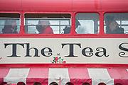 Bus tea shop - A bit of light rain brings out the waterproofs but wellies are a split decision - The 2017 Glastonbury Festival, Worthy Farm. Glastonbury, 23 June 2017