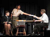 "Doreen Sheppard (Lieutenant Commander JoAnne Galloway), Saphaedrea Renee (Lawyer) and Eric Marsh (Captain Whitaker) during Laconia Streetcar Company dress rehearsal for ""A Few Good Men"" Thursday evening at Laconia High School.  (Karen Bobotas/for the Laconia Daily Sun)"