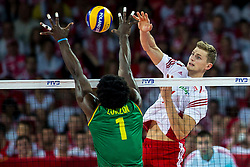 06.09.2014, Jahrhunderthalle, Breslau, POL, FIVB WM, Kamerun vs Polen, Gruppe A, im Bild Piotr Nowakowski (POL), Olivier Nongni Zanguim Mefani (CMR) // during the FIVB Volleyball Men's World Championships Pool A Match beween Cameroon and Poland at the Jahrhunderthalle in Breslau, Poland on 2014/09/06. EXPA Pictures © 2014, PhotoCredit: EXPA/ Newspix/ Lukasz Skwiot<br /> <br /> *****ATTENTION - for AUT, SLO, CRO, SRB, BIH, MAZ, TUR, SUI, SWE only*****