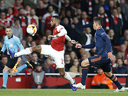 BRITAIN-LONDON-FOOTBALL-UEFA EUROPA LEAGUE-ARSENAL VS VALENCIA.(190502) -- LONDON, May 2, 2019  Arsenal's Alexandre Lacazette controls the ball ahead of Valencia's Ezequiel Garay during the UEFA Europa League semi-final first leg match between Arsenal and Valencia at The Emirates Stadium in London, Britain on May 2, 2019. Arsenal won 3-1.  FOR EDITORIAL USE ONLY. NOT FOR SALE FOR MARKETING OR ADVERTISING CAMPAIGNS. NO USE WITH UNAUTHORIZED AUDIO, VIDEO, DATA, FIXTURE LISTS, CLUB/LEAGUE LOGOS OR ''LIVE'' SERVICES. ONLINE IN-MATCH USE LIMITED TO 45 IMAGES, NO VIDEO EMULATION. NO USE IN BETTING, GAMES OR SINGLE CLUB/LEAGUE/PLAYER PUBLICATIONS. (Credit Image: © Matthew Impey/Xinhua via ZUMA Wire)