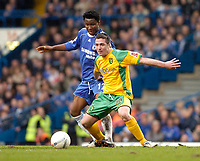 Photo: Leigh Quinnell.<br /> Chelsea v Norwich City. The FA Cup. 17/02/2007.<br /> Norwichs' Mark Fotheringham holds back Chelseas Mikel.