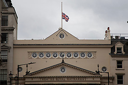 © Licensed to London News Pictures.10/04/2021. London, UK. The Union Flag flies at half mast above the Theatre Royal Haymarket. Yesterday Buckingham Palace announced that Prince Philip The Duke of Edinburgh passed away in the morning at Windsor Castle . Photo credit: George Cracknell Wright/LNP