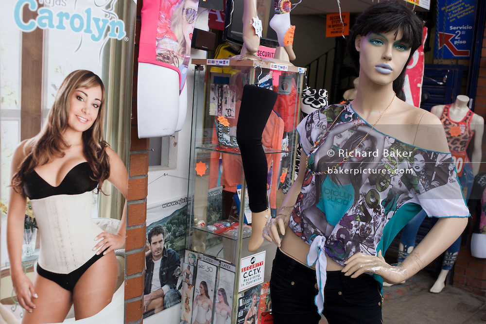 Mannequins of women show a sexist stereotype of their gender, outside a clothing business in south London.