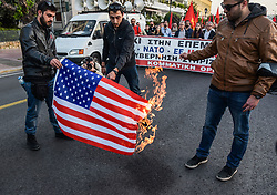April 13, 2018 - Athens, Greece - Protests burn an American flag outside the US Embassy in Athens during a rally against possible western military intervention in Syria. (Credit Image: © Dimitris Lampropoulos/NurPhoto via ZUMA Press)