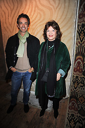 HENRY DENT-BROCKLEHURST and his mother LADY ASHCOMBE at the opening of Luke Irwin's showroom at 22 Pimlico Road, London SW1 on 24th November 2010.