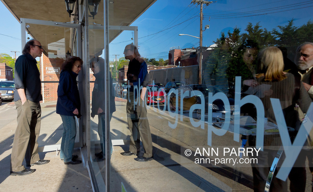 May 4, 2013 - Huntington, New York, U.S. - Visitors arrive for the Opening Reception at fotofoto Gallery, a cooperative photography gallery which is a non-profit organization.