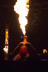 "© Licensed to London News Pictures. 15/05/2013. London, England. Picture: Coney Island performer Heather Holliday with a fire eating show. Creators of the critically-acclaimed ""Cantina"" return to London this summer (10 May to 29 September) with their new show ""Limbo"" at London Wonderground/Southbank Centre. London Wonderground headline act ""Limbo"" is a mix of cabaret, circus and acrobatics.  Photo credit: Bettina Strenske/LNP"