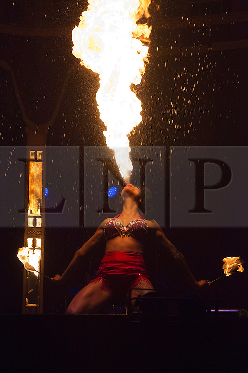 """© Licensed to London News Pictures. 15/05/2013. London, England. Picture: Coney Island performer Heather Holliday with a fire eating show. Creators of the critically-acclaimed """"Cantina"""" return to London this summer (10 May to 29 September) with their new show """"Limbo"""" at London Wonderground/Southbank Centre. London Wonderground headline act """"Limbo"""" is a mix of cabaret, circus and acrobatics.  Photo credit: Bettina Strenske/LNP"""