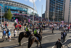 © Licensed to London News Pictures.  07/07/2021. London, UK. England football supporters arrive at Wembley Stadium, west London ahead of their EURO 2020 match against Denmark this evening. Photo credit: Marcin Nowak/LNP