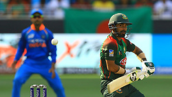September 28, 2018 - Dubai, United Arab Emirates - Bangladesh cricketer Liton Das plays a shot  during the final cricket match of Asia Cup 2018  between India and Bangladesh at Dubai International cricket stadium,Dubai, United Arab Emirates. 09-28-2018  (Credit Image: © Tharaka Basnayaka/NurPhoto/ZUMA Press)